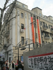 The apartment building where the protestors live, with a glimpse of their banner in the foreground.